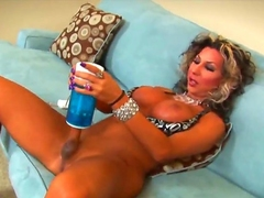 Smoking hot tanned shemale cougar Ariel Everits with obese firm hooters with an increment of smoking hot host in high heels pleasures herself with kinky jerk off kickshaw in arousing solo action.