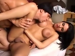 Heavy boobed brunette tgirl gets fucked on a couch